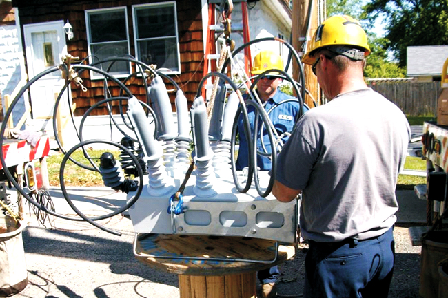 Chicopee Electric Light Company engineers installing a NOJA Power OSM Recloser