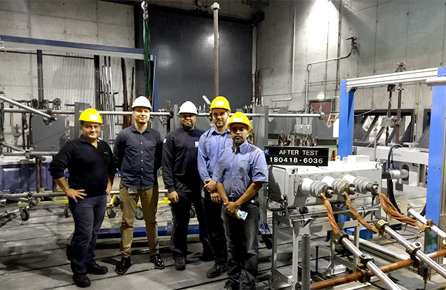 NOJA Power Staff at the KEMA Laboratory with the VISI-SWITCH (right)