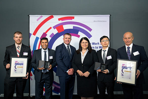 From Left To Right: Sam Griffiths (Testing Officer/NOJA Power), Dr Rabiul Alam (Quality and Safety Manager/NOJA Power), Shane Webke (Queensland's Safety Ambassador), Hon. Grace Grace (Minister for Employment and Industrial Relations), Zhihao Guo (Electric