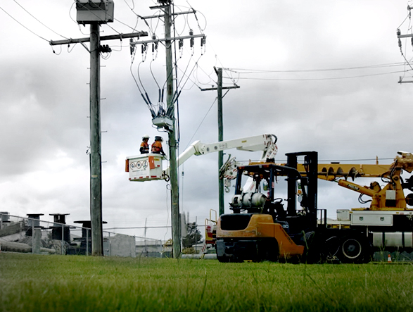 Linemen working on a NOJA Power OSM recloser