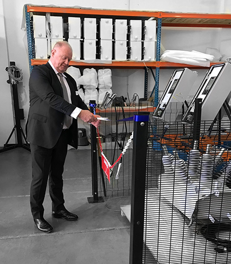 NOJA Power Group Managing Director Neil O'Sullivan cuts the ribbon opening the new RWW NOJA Power Production Line in Laser Park South Africa.
